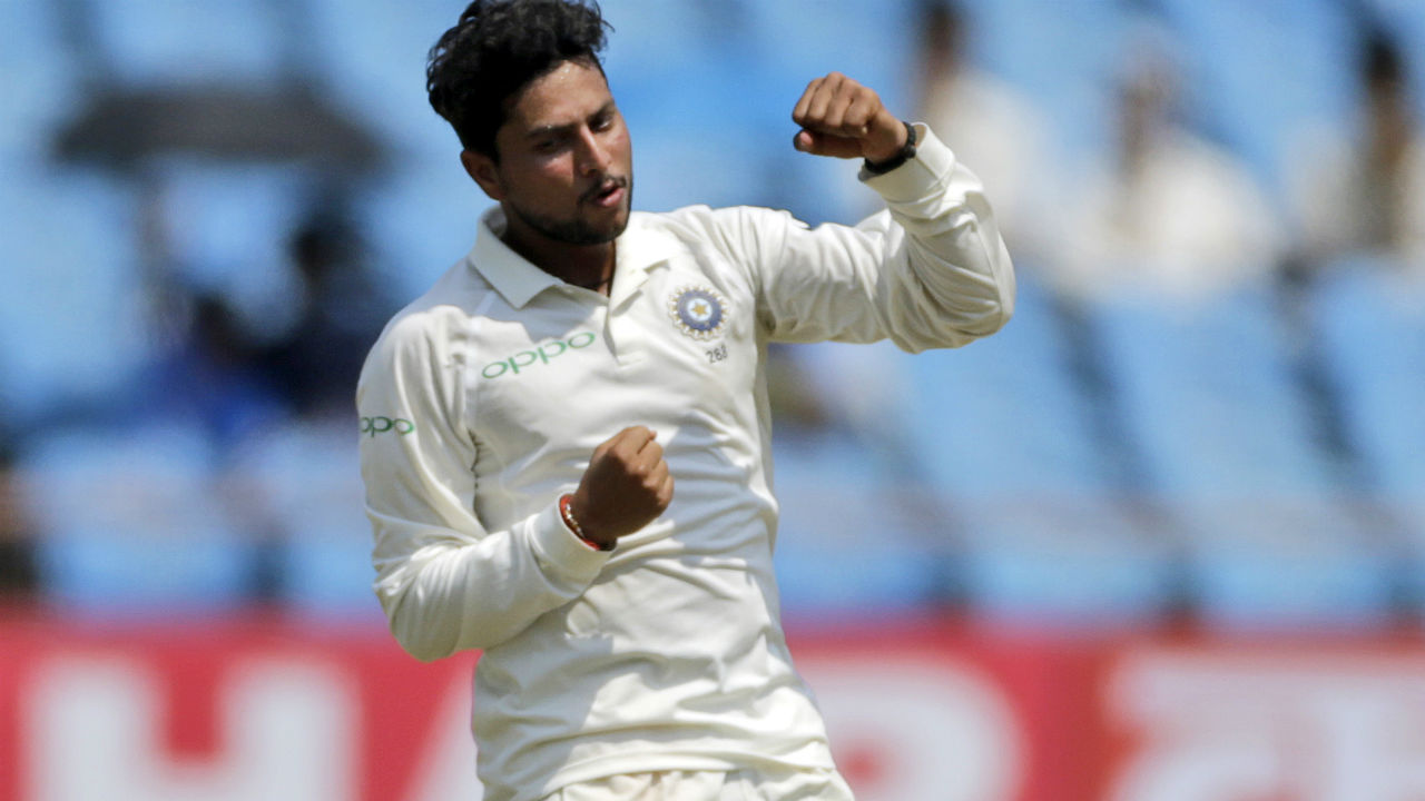 Kuldeep Yadav bowled a dream spell as he completed his maiden 5-for in Test cricket. Yadav accounted for the wickets of Keiran Powell, Roston Chase, Sunil Ambris, Shimron Hetymer and Shai Hope. (Image: AP)