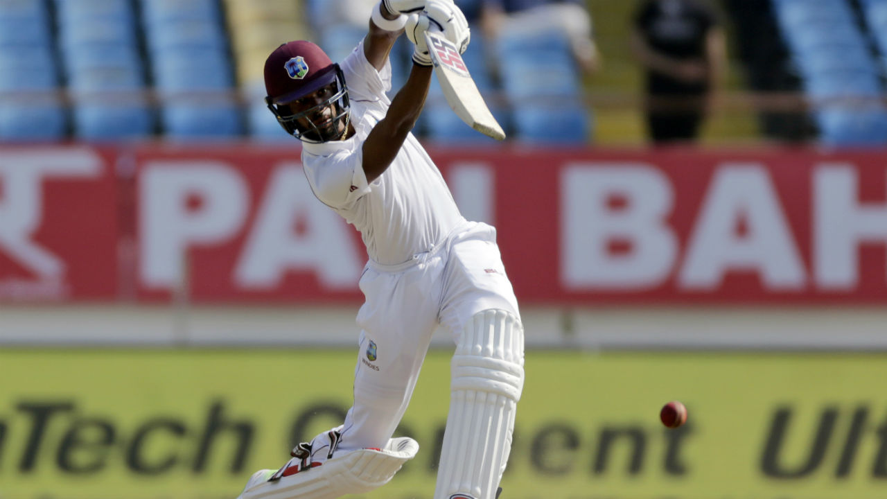 West Indies began Day 3 with positive intent as overnight batsmen Keemo Paul and Roston Chase scored some quick runs in the first few overs. Chase completed his 6th Test fifty by scoring a boundary off a Kuldeep Yadav delivery. (Image: AP)
