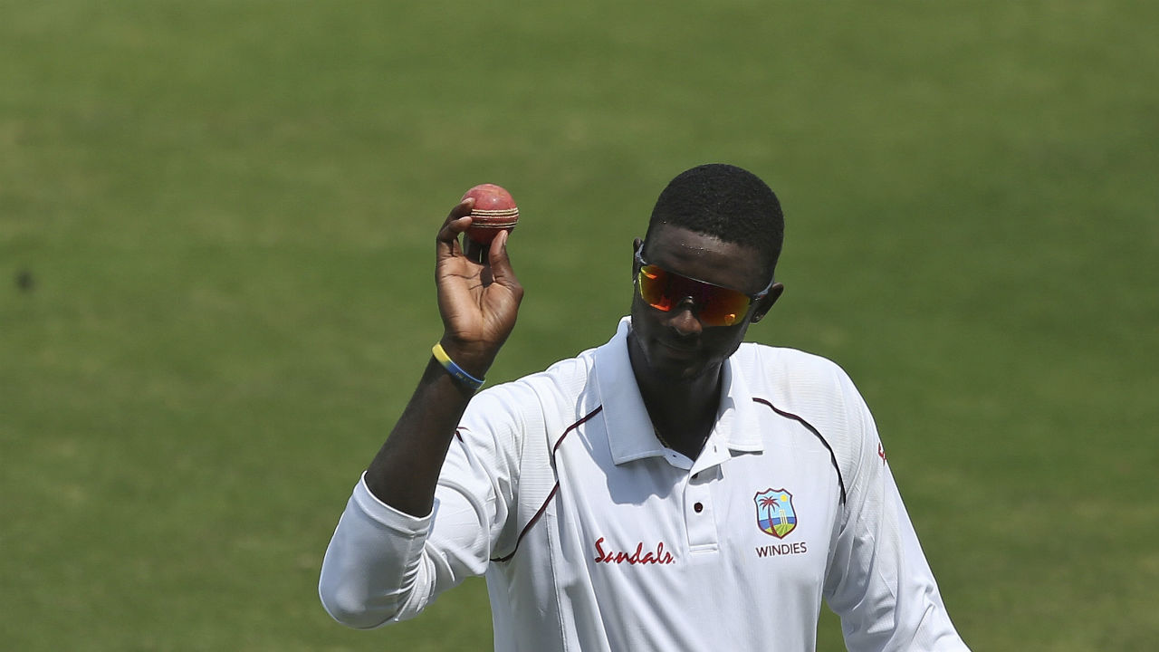 Jason holder picked his third wicket of the morning when he castled Kuldeep Yadav. That wicket completed Holder's five wicket haul in the innings. It was the talismanic bowler's fifth five-wicket haul of his Test career.(Image: AP)