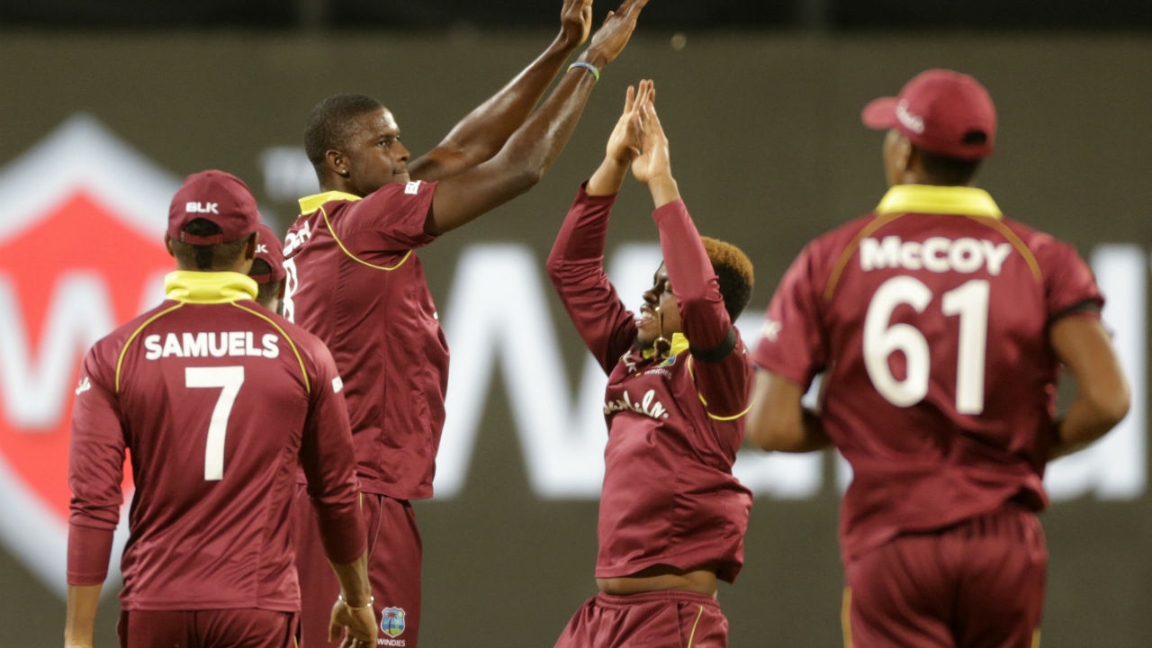 Pant scored a brisk 24 before Nurse dismissed him in the 32nd over. Windies skipper Jason Holder then dismissed struggling M S Dhoni to keep his team's hopes alive in the contest. Dhoni scored only 7 runs off 11 deliveries. At fall of Dhoni's wicket India's score read 194/5. (Image: AP)