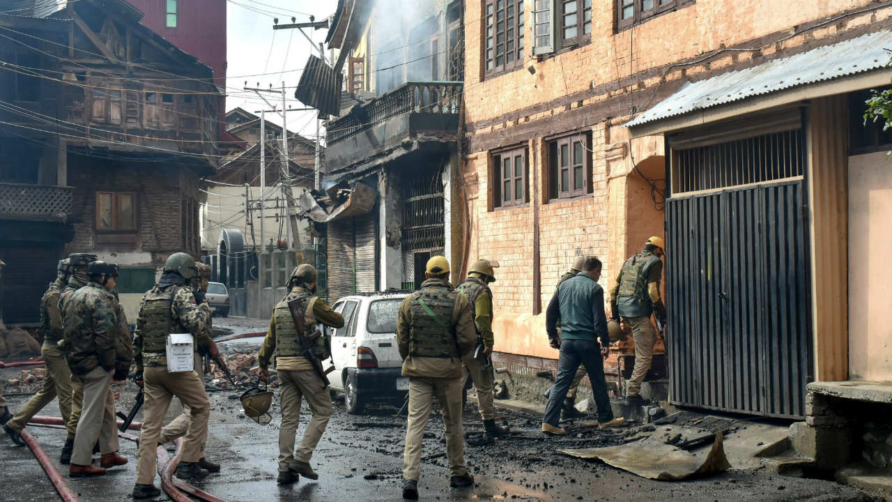 Special Operation Group (SOG) of Jammu and Kashmir Police and other security personnel search a damaged house which was gutted during an encounter, in which three militants including a top Lashkar-e-Taiba (LeT) militant commander Mehraj-ud-Bangroo and a policeman were killed, at Fathe Kadal in Srinagar. (Image: PTI)