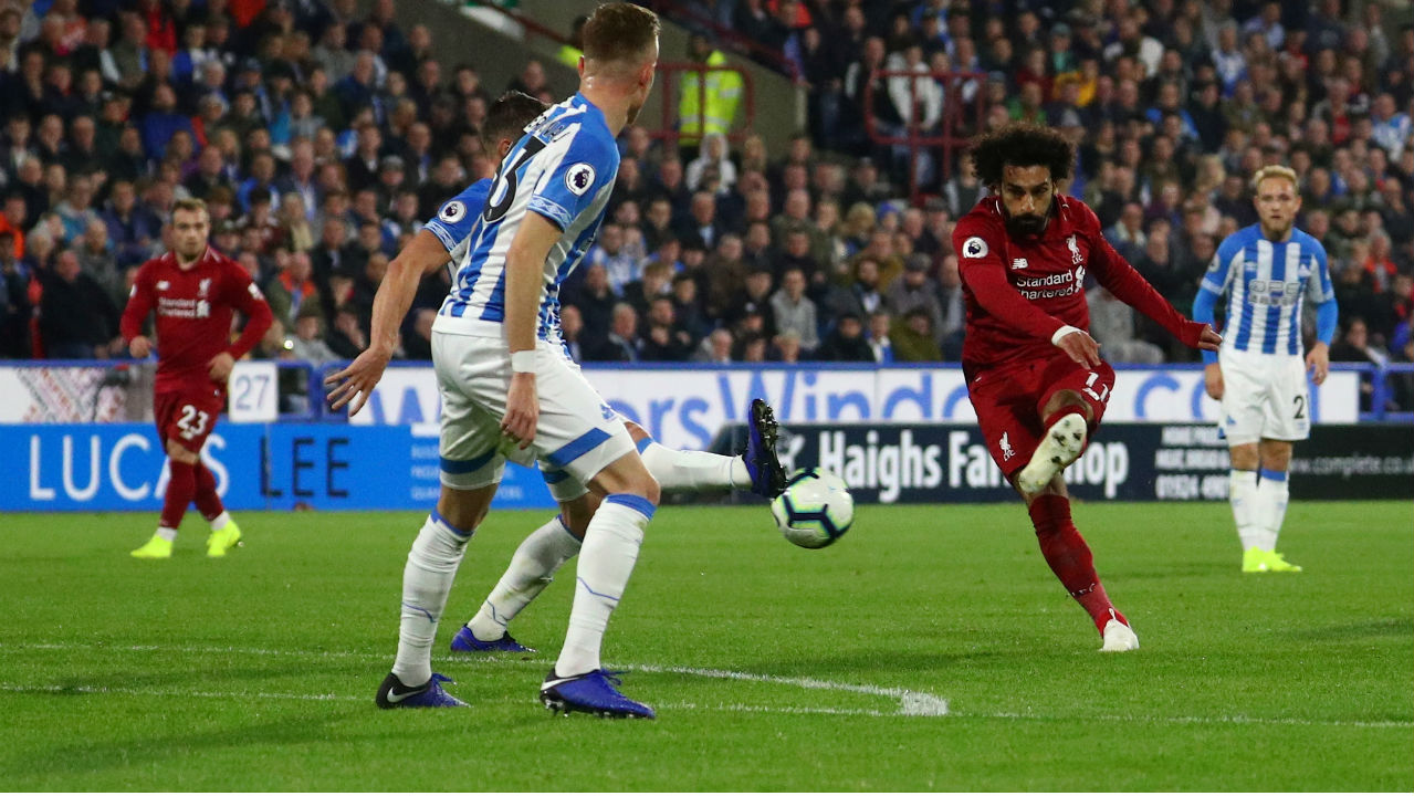Huddersfield Town 0-1 Liverpool | Liverpool ground out a 1-0 win at Huddersfield as Mohamed Salah's goal took them back up to second place. The Reds were far from their best, but Salah's clinical finish before the break proved enough for the points against a home side lacking a cutting edge. Liverpool remain unbeaten this season. (Image: Reuters)