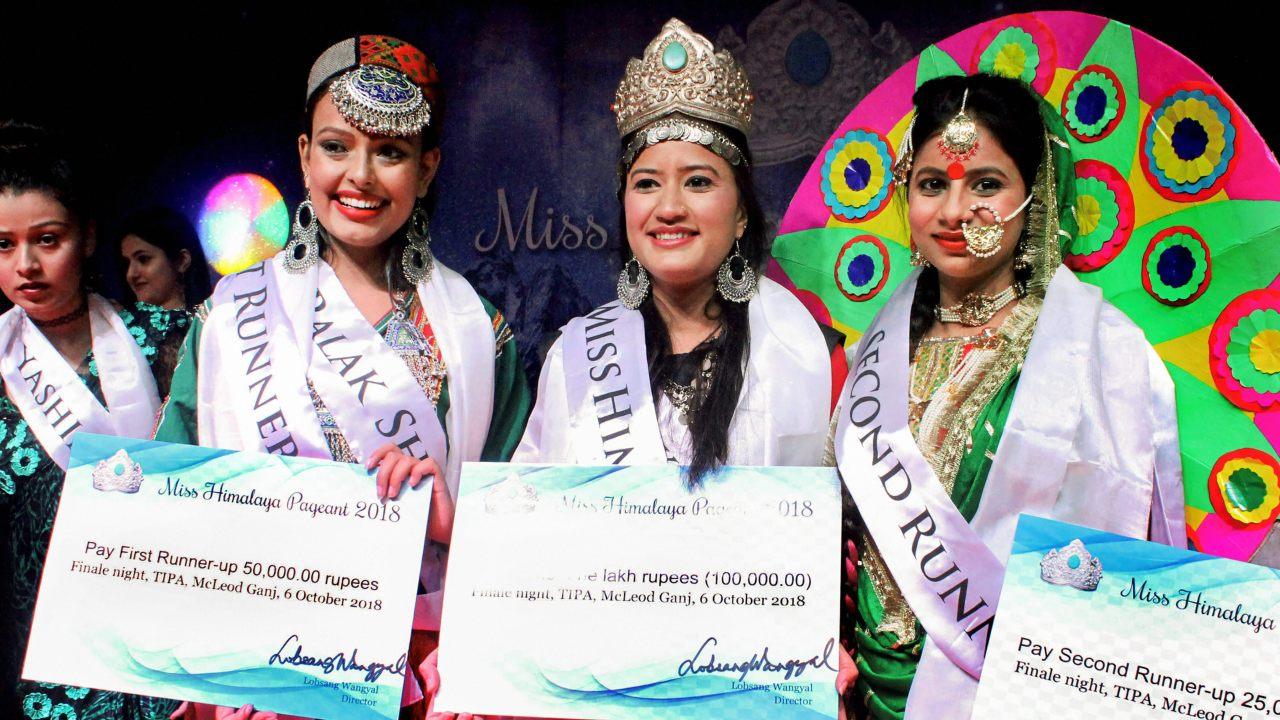 Winner Ritika Sharma flanked by first runner-up Palak Sharma (L) and second runner-up Ashima Sharma during finals of Miss Himalaya Pageant 2018 at McLeod Ganj near Dharamshala. (Image: PTI)