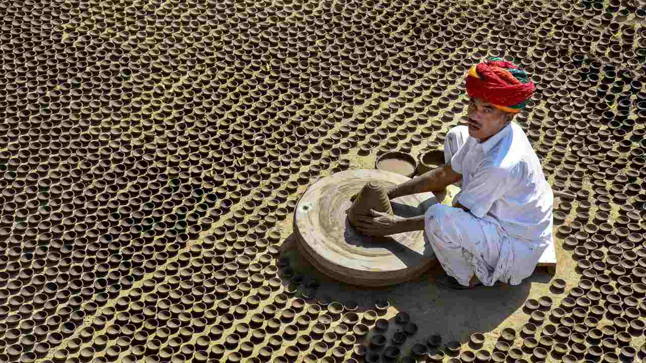 A potter makes earthen lamps or 'diyas' ahead of the Diwali festival in Jodhpur, Rajasthan. (PTI)