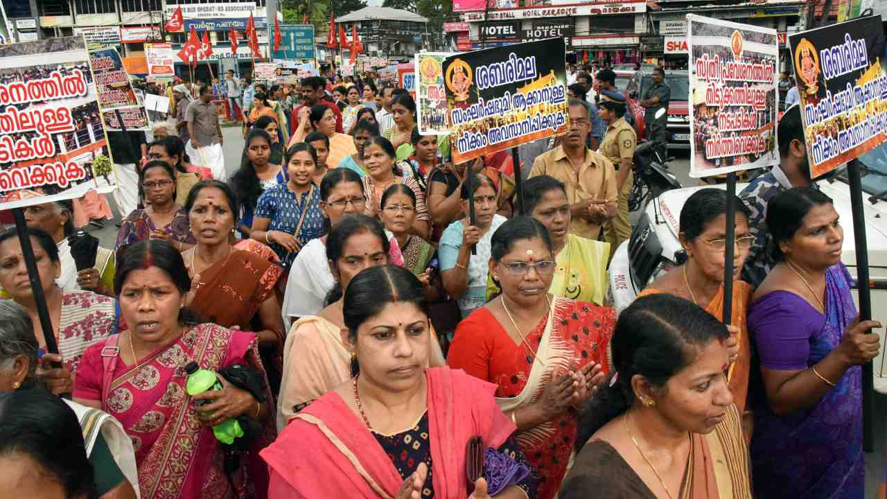 Devotees, mostly women, take part in the 'namajapa' (chanting the name of Lord Ayyappa ) march at Kaloor in Ernakulam, against the Supreme Court verdict on the entry of women of all ages into the Sabarimala Lord Ayyappa Temple. (PTI)