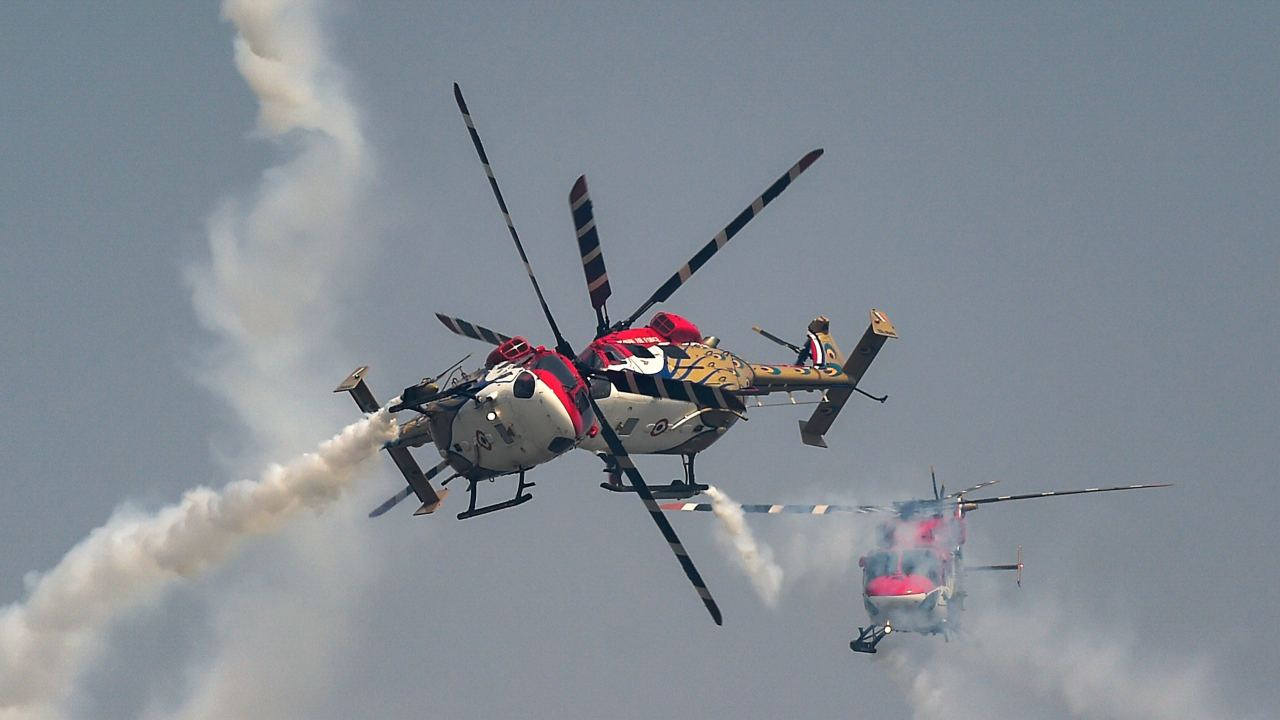 'Sarang' helicopter aerobatic team of Indian Air Force performs at the  86th Air Force Day Parade 2018, at Air Force Station, Hindon in Ghaziabad. (PTI)