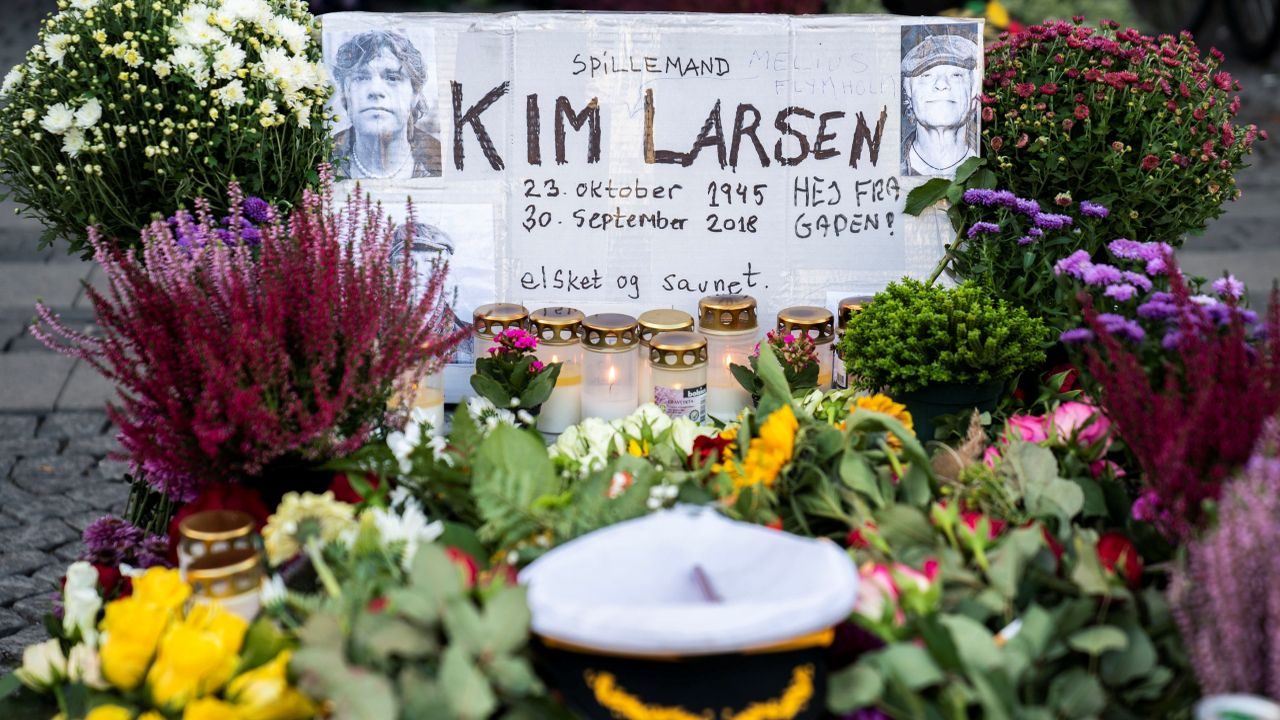 Flowers, beers and cards continue to flow on Christianshavns Torv in honor of the Danes' national singer Kim Larsen, 72, who died on September 30, 2018, in Copenhagen, Denmark. (Reuters)