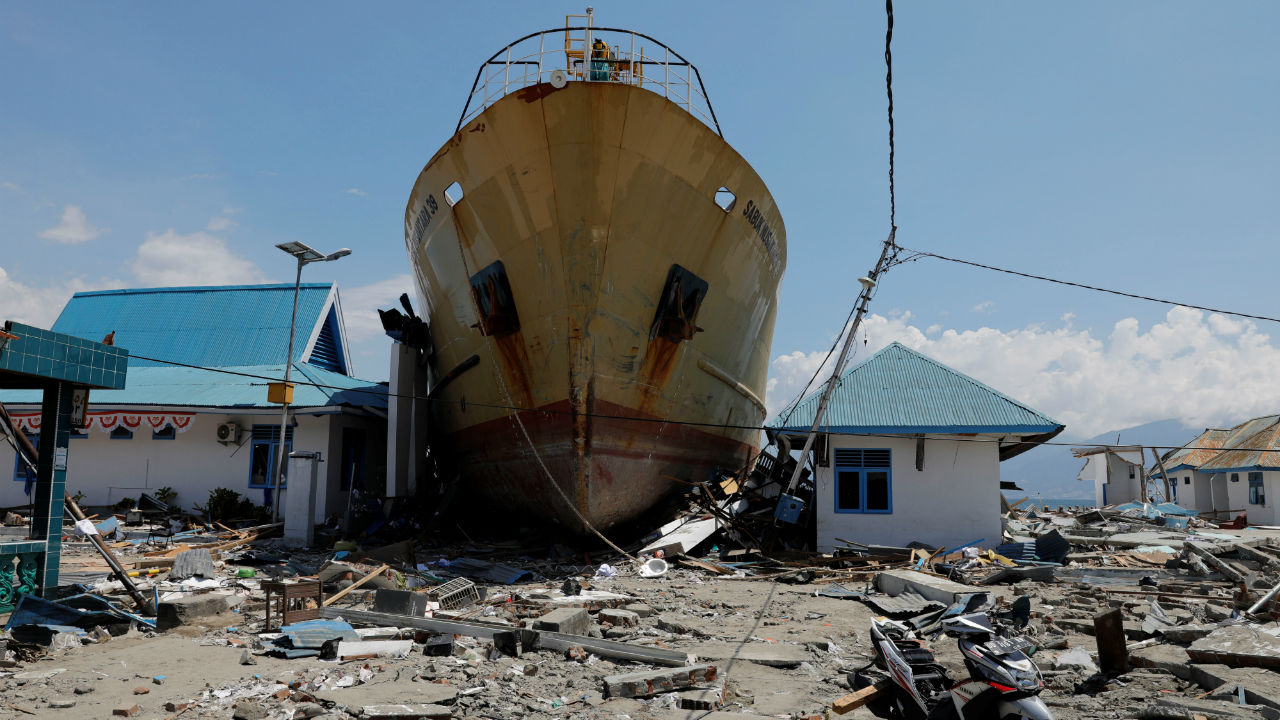 A ship is seen stranded on the shore after an earthquake and tsunami hit the area in Wani, Donggala, Central Sulawesi, Indonesia. (Image: Reuters)