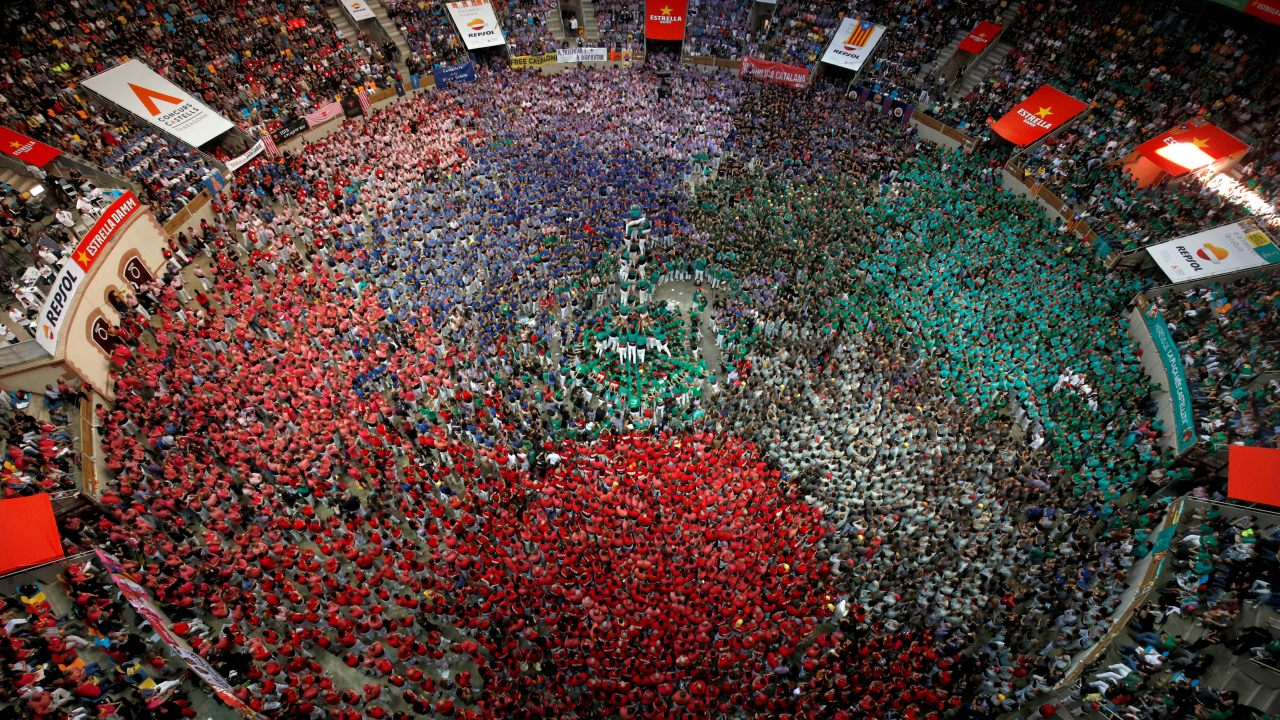 "Members of group ""Castellers de Sabadell"" form a human tower called ""castell"" during a biannual human tower competition in Tarragona, Spain. (Image: Reuters)"