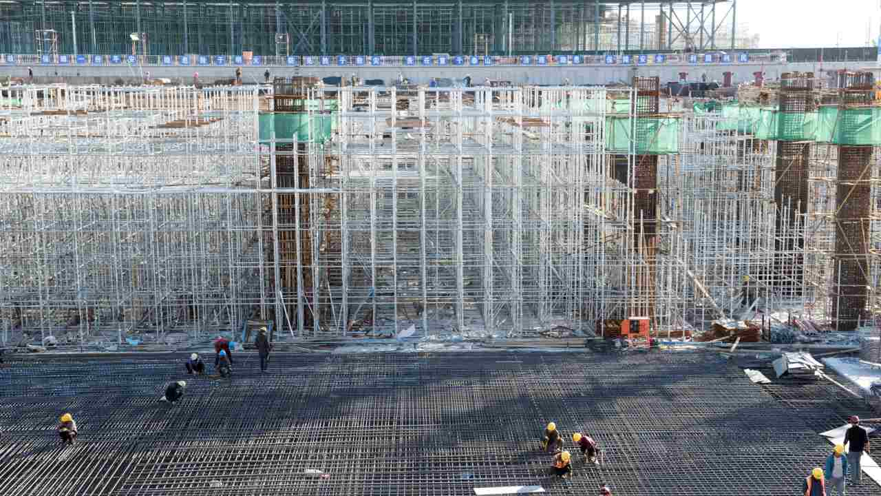 Workers are seen at the construction site of Zhangjiakou South railway station in Hebei province, China. (REUTERS)