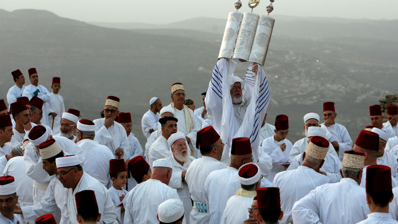 Members of the Samaritan community take part in a traditional pilgrimage marking the holiday of Sukkot, or Feast of Tabernacles, atop Mount Gerizim near Nablus in the West Bank. (Image: Reuters)