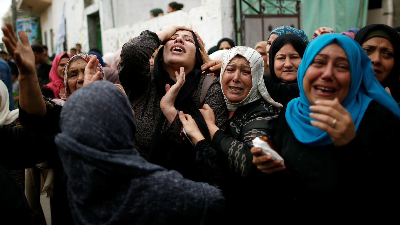 A relative of Palestinian gunman Naji al-Zaneen, who was killed in an Israeli air strike, reacts during his funeral in the northern Gaza Strip. (Image: Reuters)