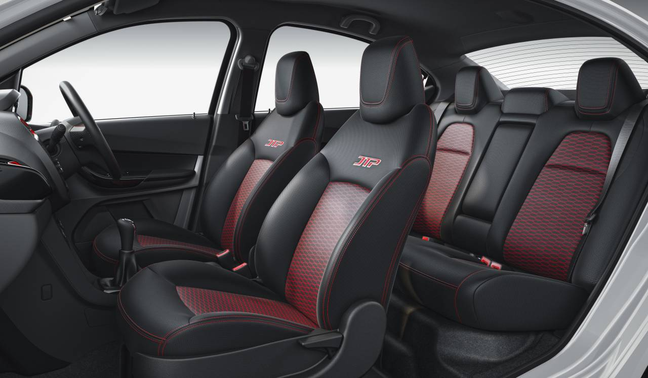 The interiors have been crafted with a unique red fabric with a red hexagonal motif. It also features double stitches with red threading on the seats and gearshift gaiter, differentiating it from other models from the Tata stable. (Image: Tata Motors)