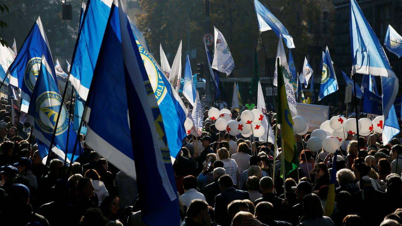 Demonstrators take part in a protest rally organised by Ukrainian labour unions in central Kiev, Ukraine. (Image: Reuters)
