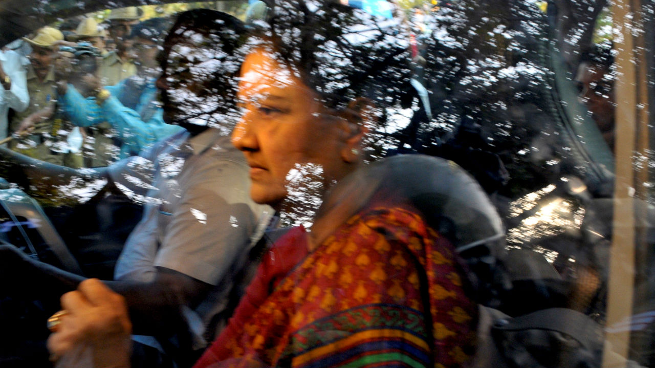 VK Sasikala, then General Secretary of AIADMK, sits inside her car as she arrives to surrender at the central jail in Bengaluru, Karnataka on February 15, 2017. (Image: Reuters)