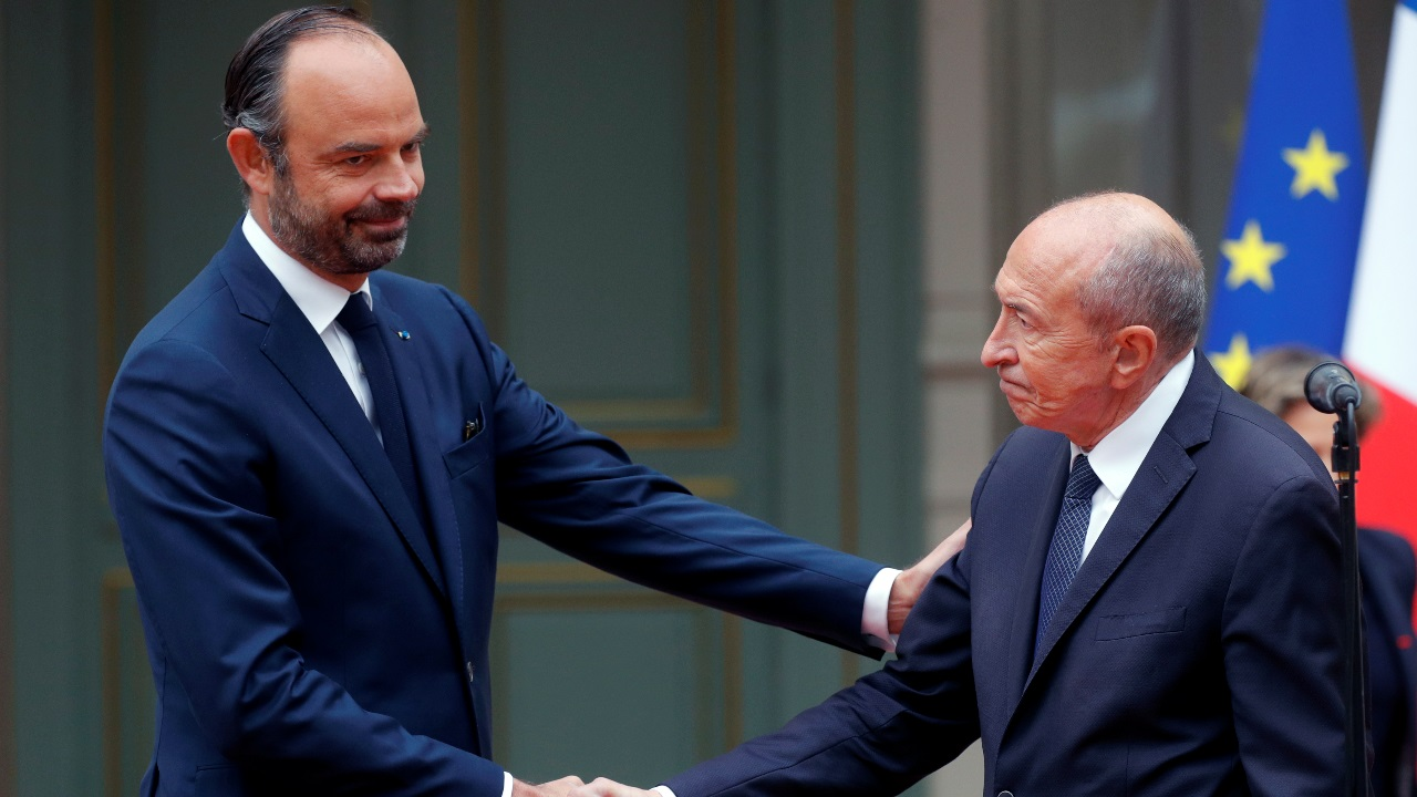 Gerard Collomb, outgoing French Interior Minister, shakes hands with French Prime Minister Edouard Philippe, appointed interim Interior Minister, during a handover ceremony in Paris, France. (Image: Reuters)
