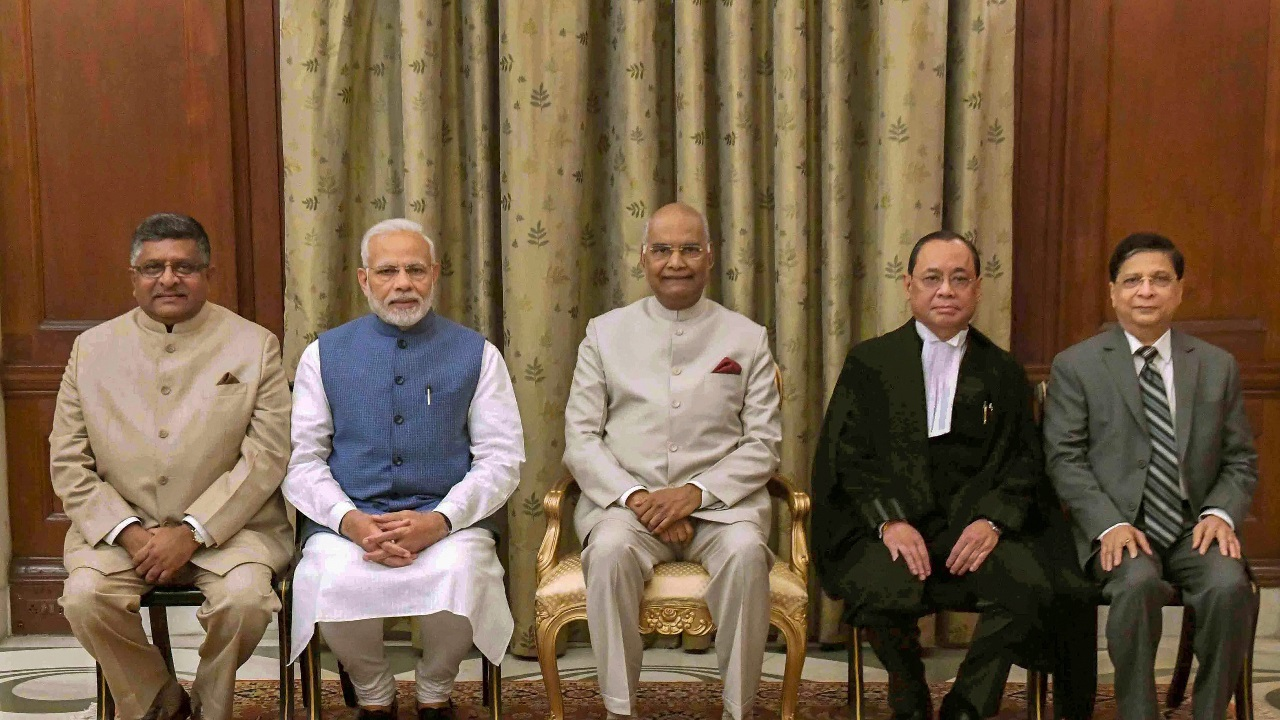 President Ram Nath Kovind (C) flanked by newly sworn-in Chief Justice of India Justice Ranjan Gogoi (2nd R) and Prime Minister Narendra Modi (2nd L), after the oath taking ceremony, at Rashtrapati Bhawan, in New Delhi. Also seen are Union Law Minister Ravi Shankar Prasad (L) and former CJI Justice Dipak Misra (R). (Image: PTI)