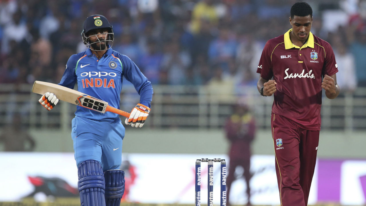 Obed McCoy had a mixed outing on his debut as he got the important wicket of MS Dhoni and Ravindra Jadeja. He was also expensive as he gave away 71 runs in his 9 overs. Kohli and Jadeja stitched together a 59-run partnership for the 6th wicket which helped India reach 321 after 50 overs. Kohli remained unbeaten on 157 runs. (Image: AP)