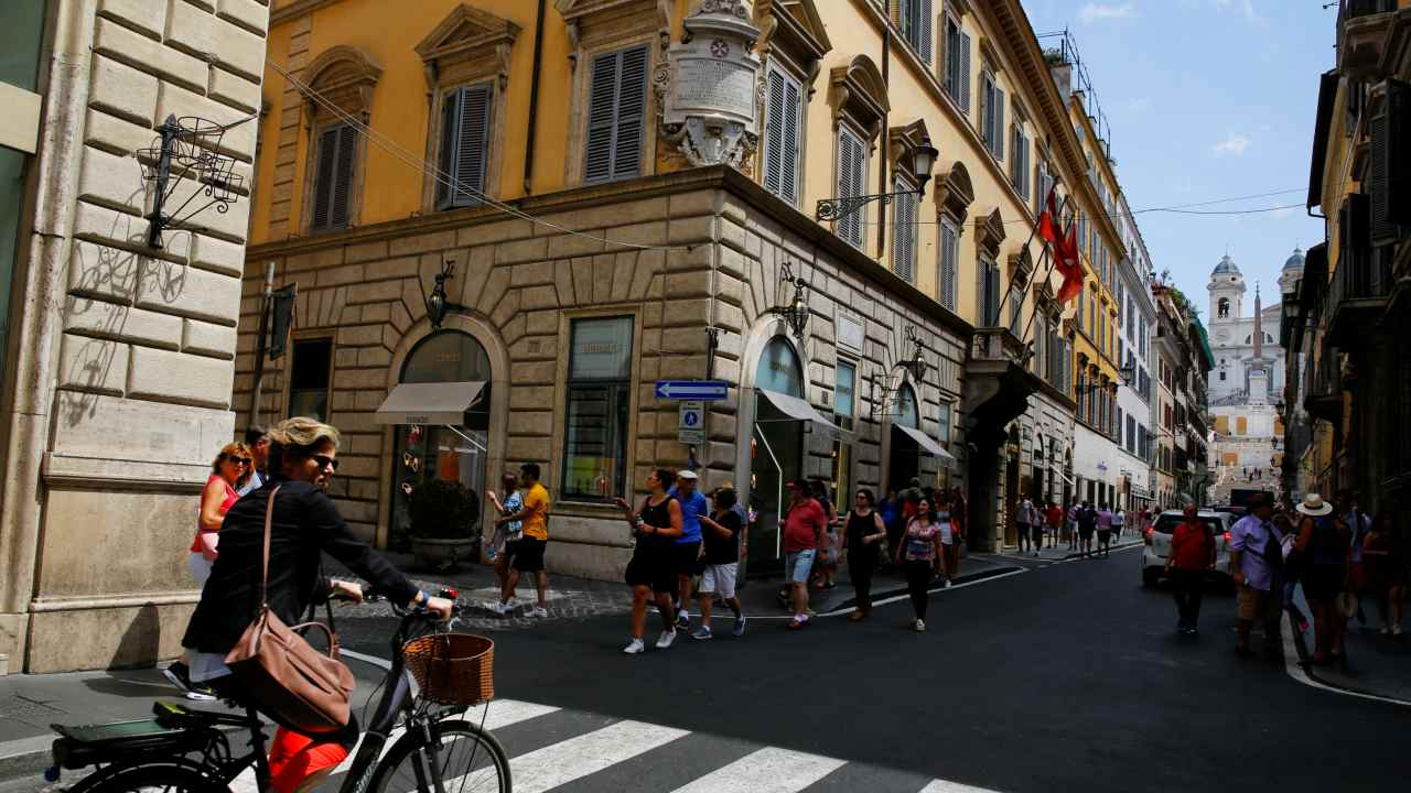 Italy | Prices have soared to become the most expensive at Rs 131.68 per litre. Tourists walk in Via dei Condotti street in downtown Rome. (Image: REUTERS)
