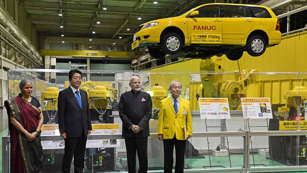 During the first day of the annual summit, the two leaders also visited one of the largest robot making companies- FANUC. Reports suggest that at the facility Modi witnessed the assembling of a motor by a robot in 40 seconds. (Image: PTI)