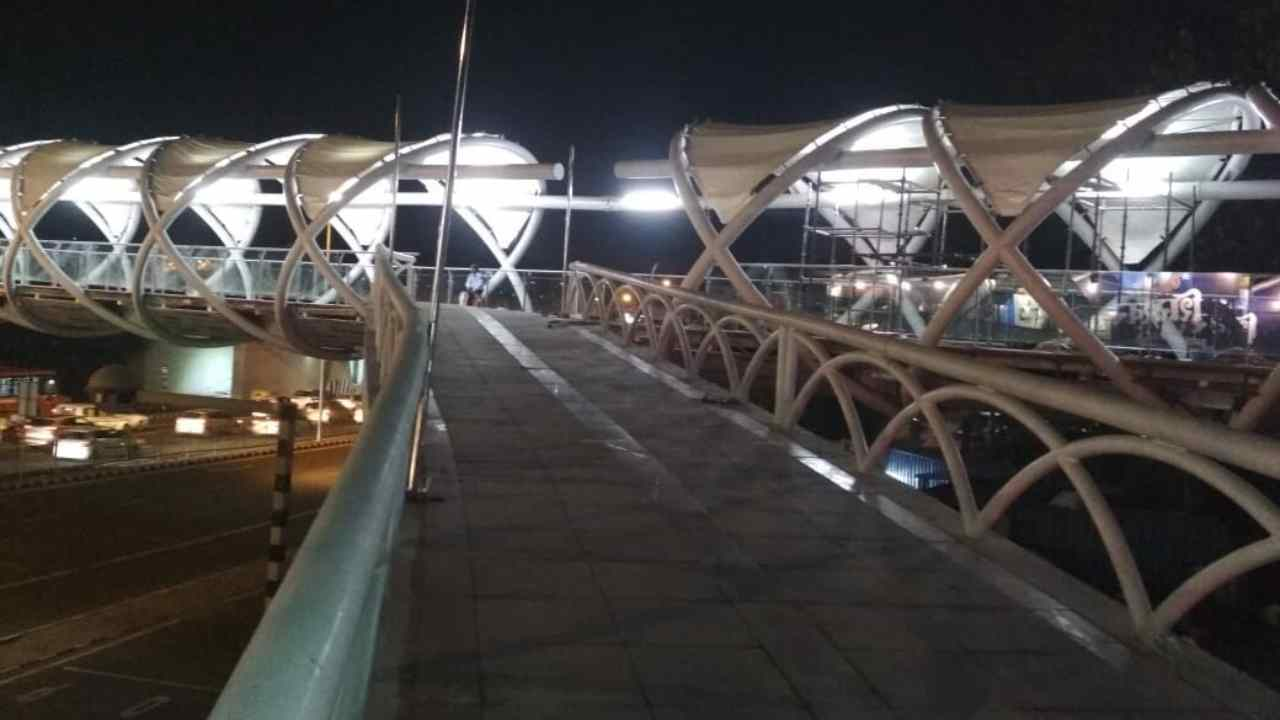 The skywalk and FOB have been constructed in steel. The granite flooring and stainless steel railing have also been provided. The structure has tensile fabric roofing.