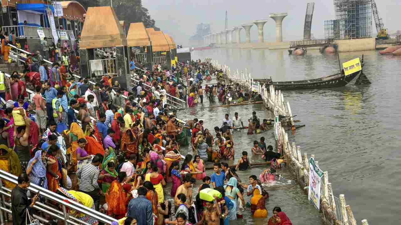 Devotees take a holy dip in the Ganga river during 'Nahay Khay' Puja of the Chhath Puja festival, in Patna. (PTI)
