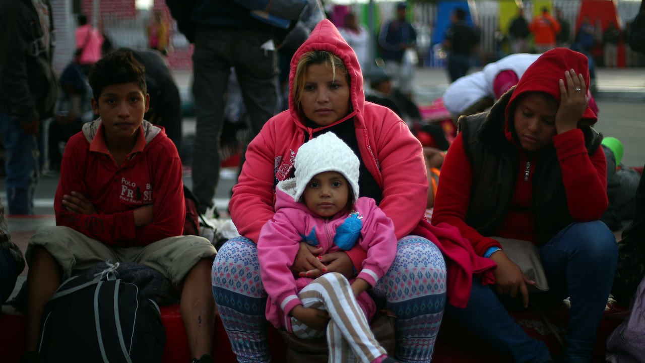 Migrants, part of a caravan of thousands from Central America trying to reach the United States, sit on the roadside outside of the El Chaparral port of entry border crossing between Mexico and the United States, in Tijuana, Mexico. (Image: Reuters)