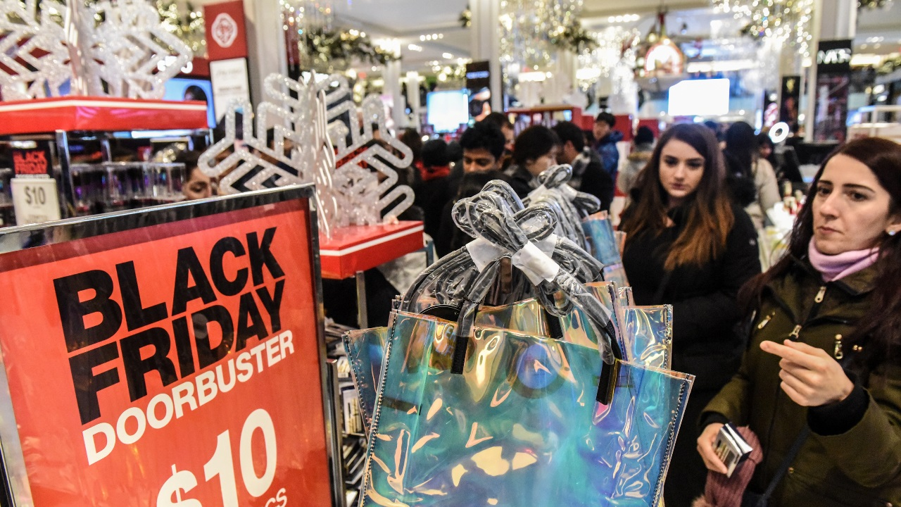 People shop during a Black Friday sales event at Macy's flagship store on 34th St. in New York City, US. (Image: Reuters)