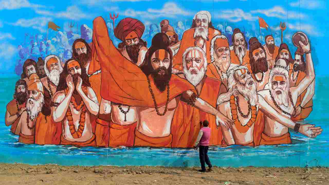 An artist makes a mural painting at a wall of the Naini Central Jail as part of the project 'Paint my City' for the upcoming Kumbh Mela festival, in Allahabad. (PTI)