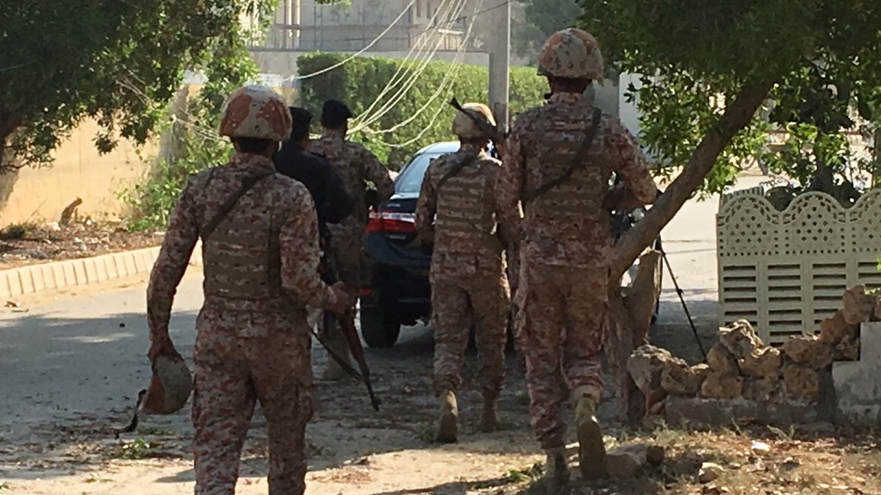 Paramilitary forces and police are seen during an attack on the Chinese consulate, where blasts and shots are heard, in Karachi, Pakistan. (Image: Reuters)
