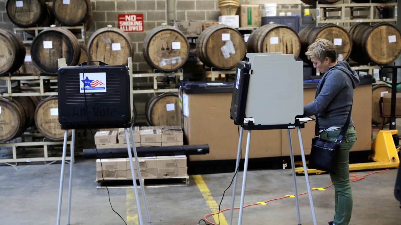 A voter casts her ballot during the midterm election at the Half Acre brewery in Chicago, Illinois. (Image: Reuters)