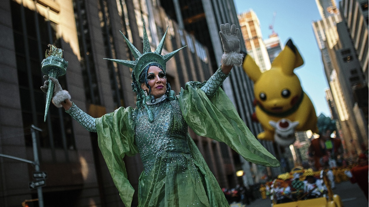 Performers and balloons move through Sixth Avenue during the Macy's Thanksgiving Day Parade in New York. (Image: AP/PTI)