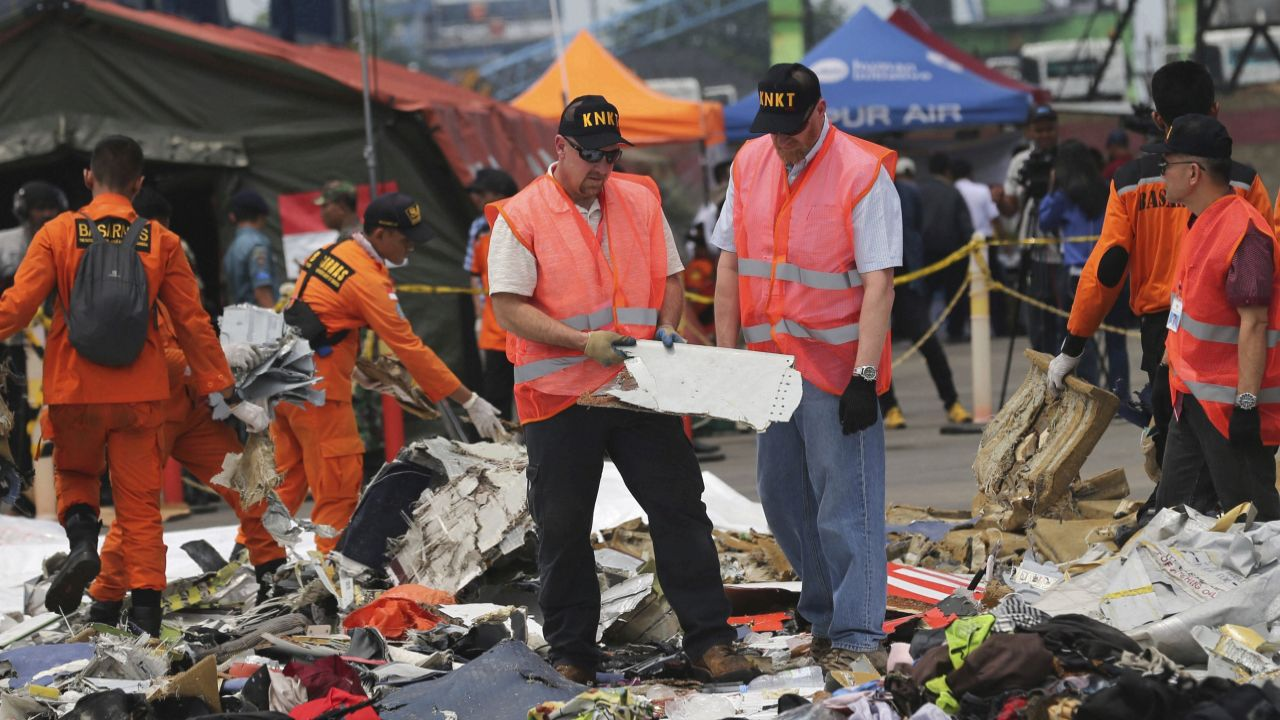 Investigators examine parts of a Lion Air jet that crashed into the sea at Tanjung Priok Port in Jakarta, Indonesia. Divers recovered the flight data recorder from the Boeing 737 MAX 8 plane crashed early Monday on the seafloor, a crucial development in the investigation into what caused the 2-month-old plane to plunge into Indonesian seas earlier this week, killing all people on board. (AP/PTI)