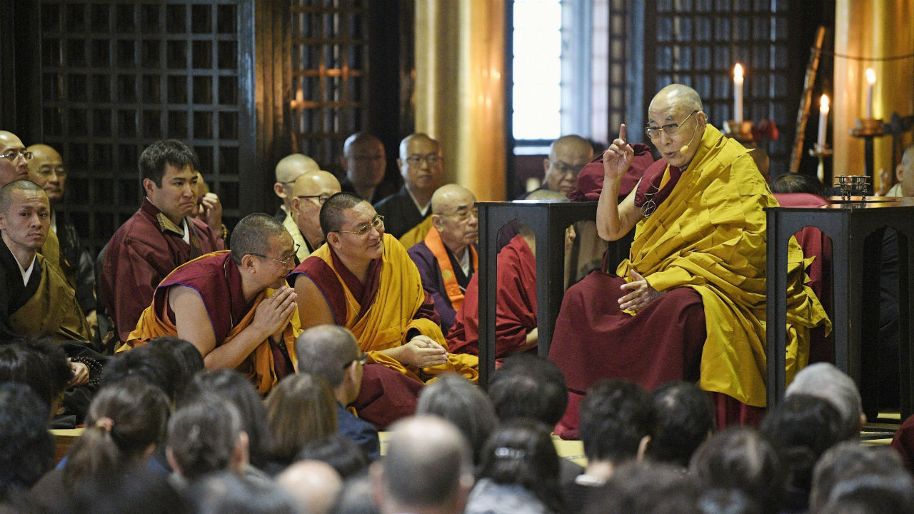 The Dalai Lama (right) delivers a sermon at Tochoji temple in the south-western Japan city of Fukuoka. The Dalai Lama is in Japan to perform a religious ceremony for the victims of the 2016 earthquake in Kumamoto and this year's natural disasters. (Image: PTI)