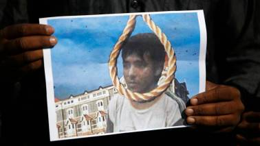 Kasab was 'grinning' while firing at commuters: Railway announcer