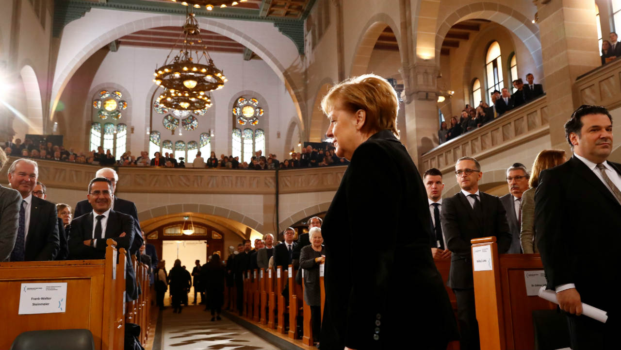 German Chancellor Angela Merkel arrives for a ceremony marking the 80th anniversary of Kristallnacht, also known as the Night of Broken Glass, at Rykestrasse Synagogue, in Berlin, Germany. (Image: Reuters)