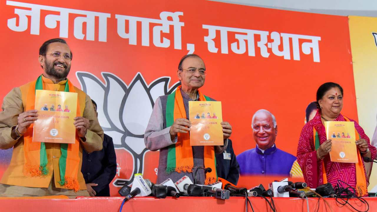 Union Ministers Arun Jaitley and Prakash Javadekar, along with Rajasthan Chief Minister Vasundhara Raje, release the party manifesto in on November 27. (Image: PTI)