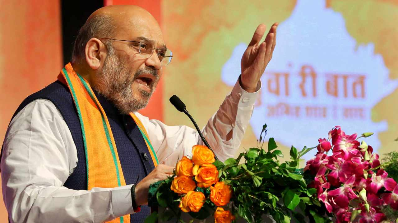 BJP President Amit Shah addresses the crowd during the party function 'Yuva Ree Baat Amit Shah Ke Saath', in Jaipur. (Image: PTI)