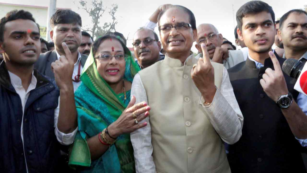 Incumbent chief minister of Madhya Pradesh Shivraj Singh Chouhan, his wife Sadhna Singh and two sons Kartikeya and Kunal show their marked fingers after casting their votes at Jait village in Bhopal. (Image: PTI)