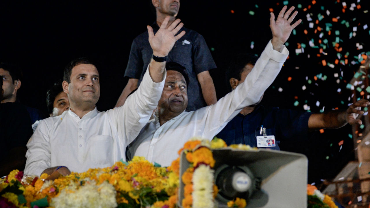 Congress President Rahul Gandhi and MPCC chief Kamal Nath greet supporters during a road show in Indore, Madhya Pradesh on October 29. (Image: PTI)