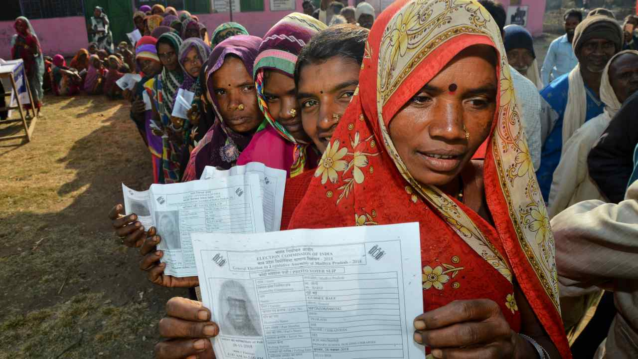 Women belonging to the Gond tribe caste their votes during the Madhya Pradesh assembly election in a remote village Chirapondi, about 50 Kilometre from Jabalpur. (Image: AP)