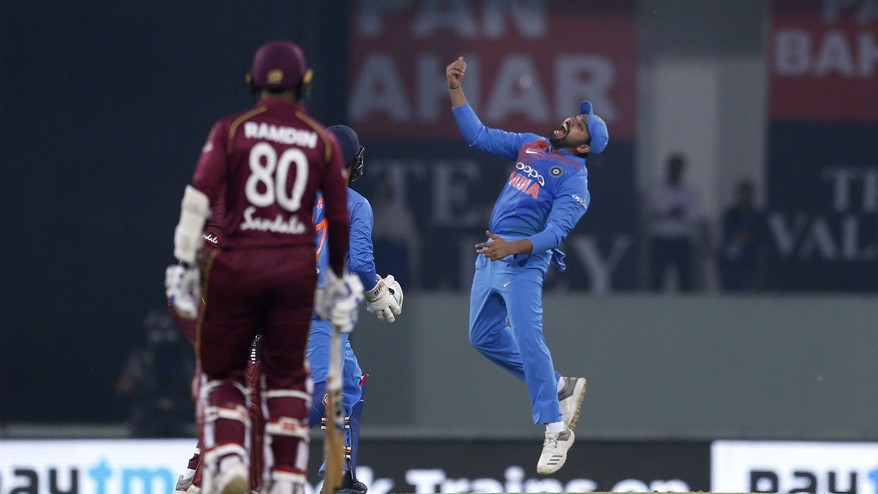 Kuldeep Yadav then scalped the wickets of Darren Bravo and Nicholas Pooran in a single over to leave the Windies reeling at 52/4. Rohit Sharma took a sharp catch in the slips to send Bravo back while Pooran was castled by a googly. (Image: AP)