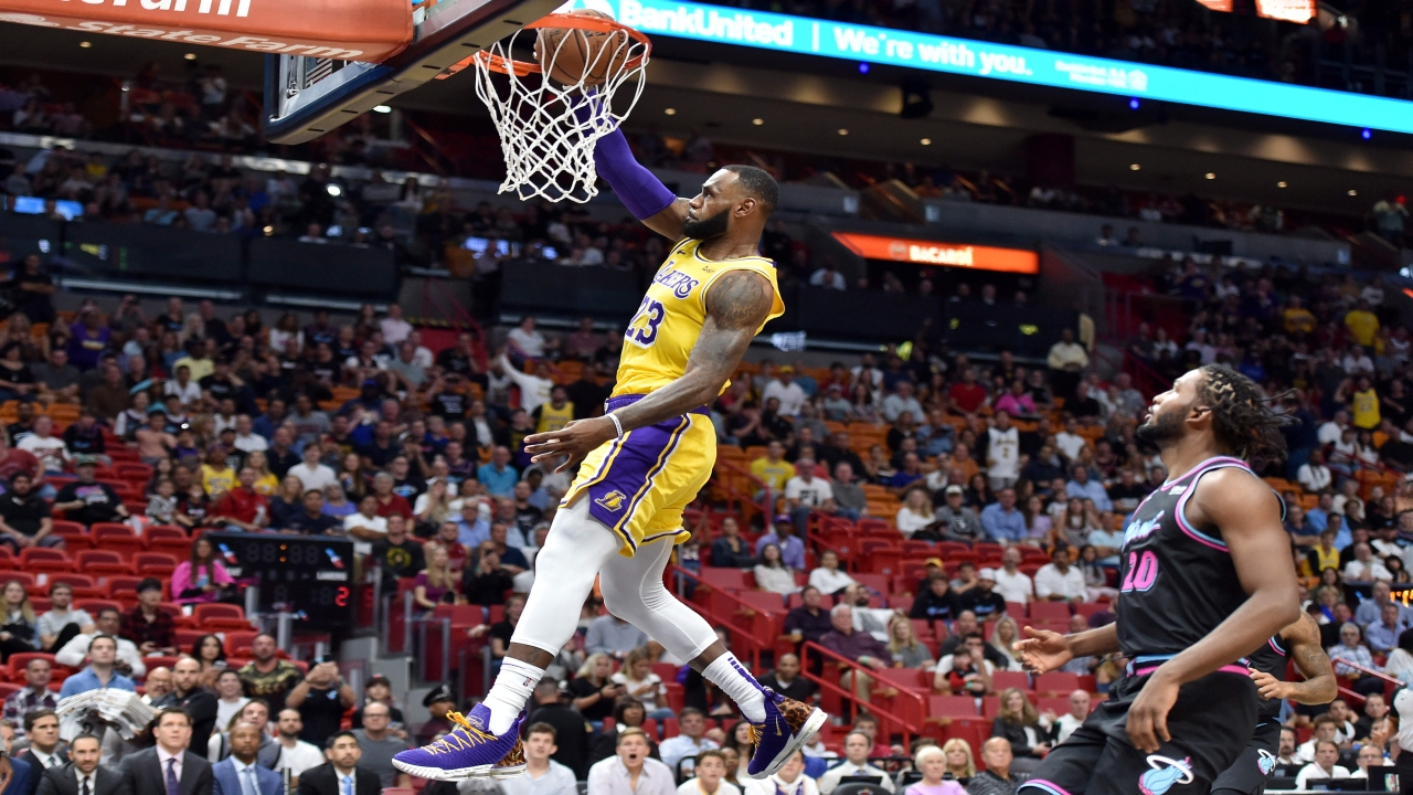 Los Angeles Lakers forward LeBron James (23) dunks as Miami Heat forward Justise Winslow (20) watches during the first half at American Airlines Arena. (Image Source: Reuters)