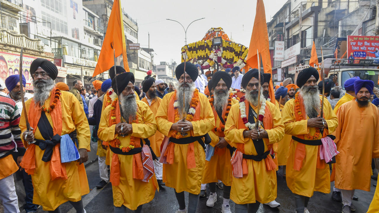 Sikh devotees participate in Nagar Kirtan (religious procession) ahead of the birth anniversary of Guru Nanak Dev Ji, in New Delhi. (Image: PTI)