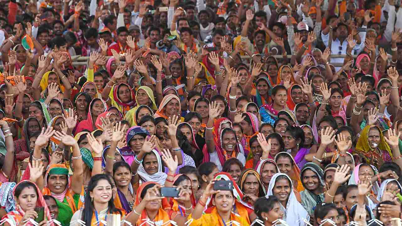People gather to attend Prime Minister Narendra Modi's election rally in Bhilwara, Rajasthan. (PTI)