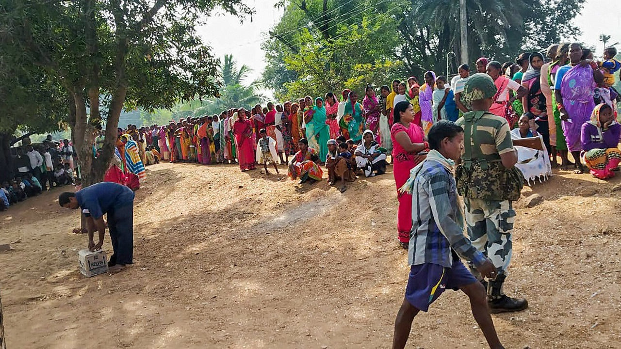 A serpentine queue outside a polling station in Solana, Hamirgarh. (Image: PTI)