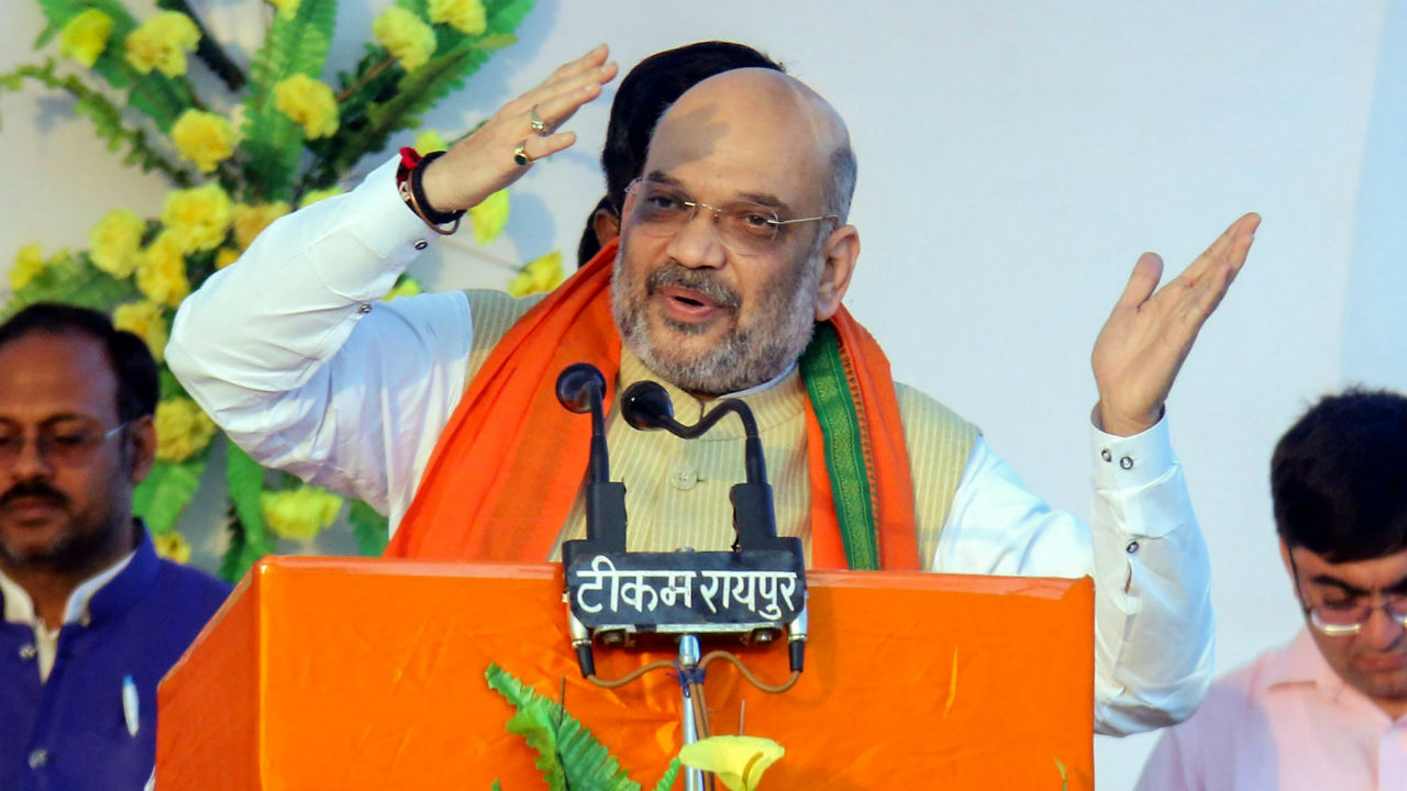 BJP National President Amit Shah addressing a public meeting on November 20 in Patan, Durg district. (Image: PTI)