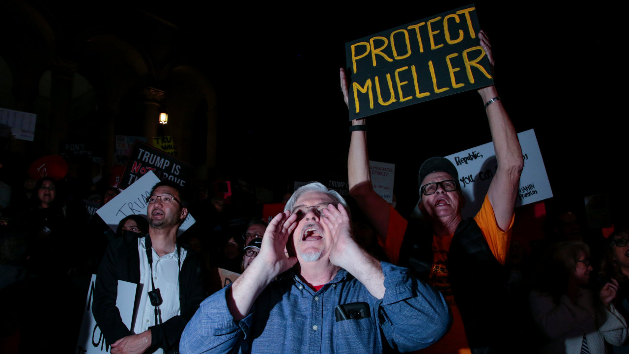 People gather in front of City Hall to take part in a protest to protect the investigation led by Special Counsel Robert Mueller, in Los Angeles, California. (Image: Reuters)