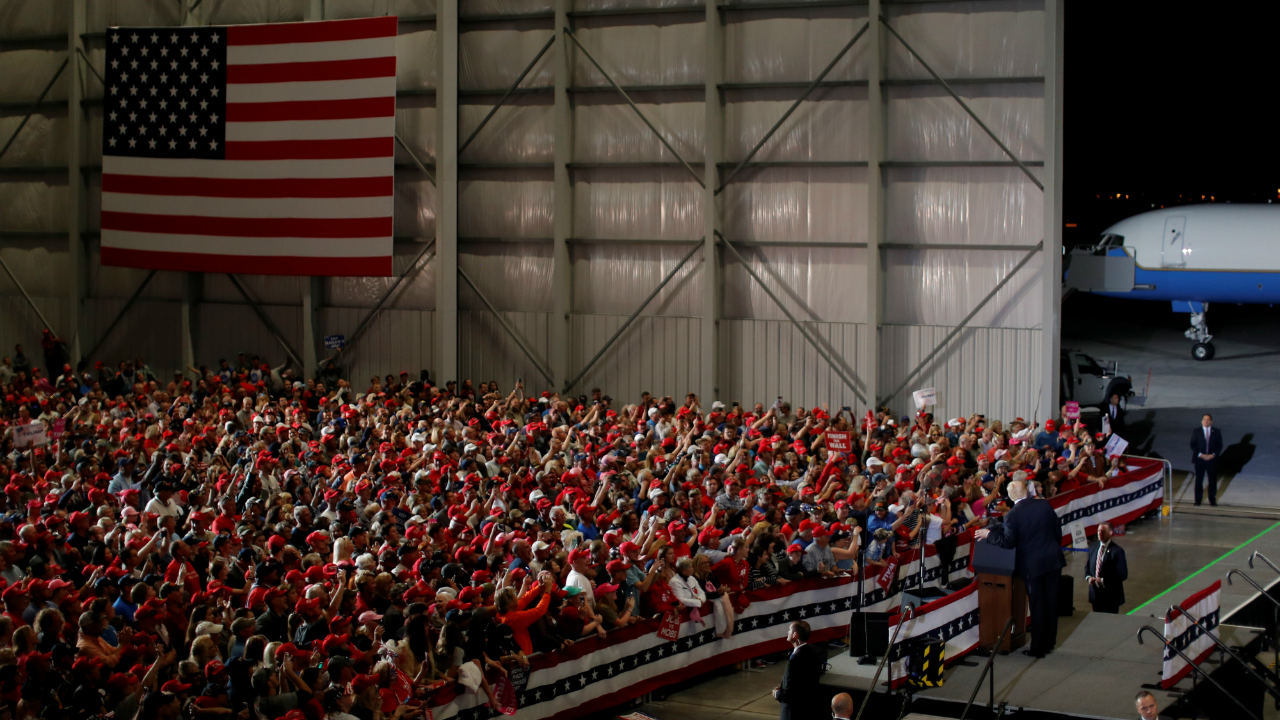 Supporters listen as US President Donald Trump speaks during a campaign rally, ahead of midterm elections, at Pensacola International Airport in Florida, US. (Image: Reuters)