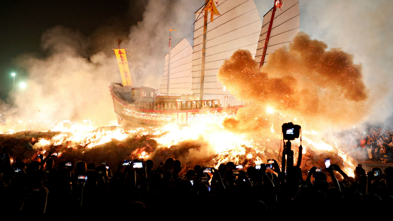 'Wang Yeh's Boat', a 13-meter finely crafted ancient warship made of paper and wood sets on fire to ward off evil, disease and bad luck during Wang Yeh Boat Burning Festival, in Pingtung, Taiwan. (Image: Reuters)